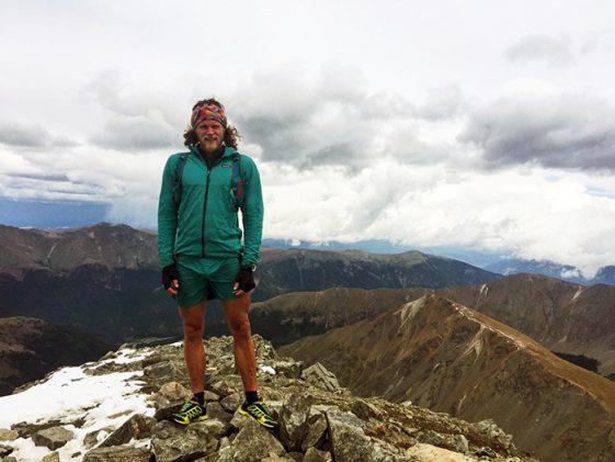 © Ron Braselton. Joe Grant stands atop 14,275-foot Torreys Peak