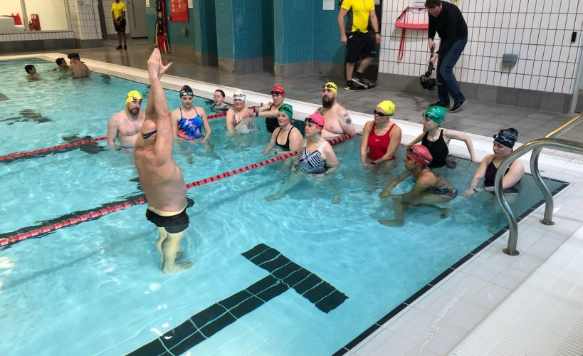 Duncan Goodhew giving Swimathon ambassadors some tips in the pool.