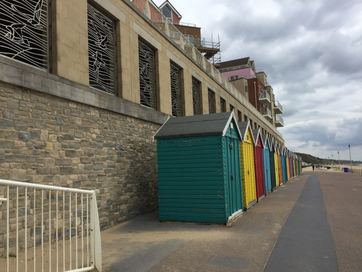 Row of brightly coloured beach huts at Boscombe.