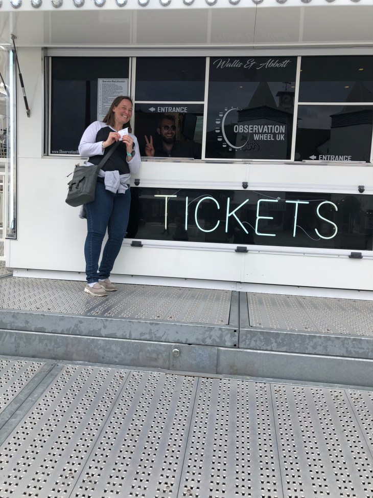 Tamsyn buying tickets for the observation wheel in Bournemouth.