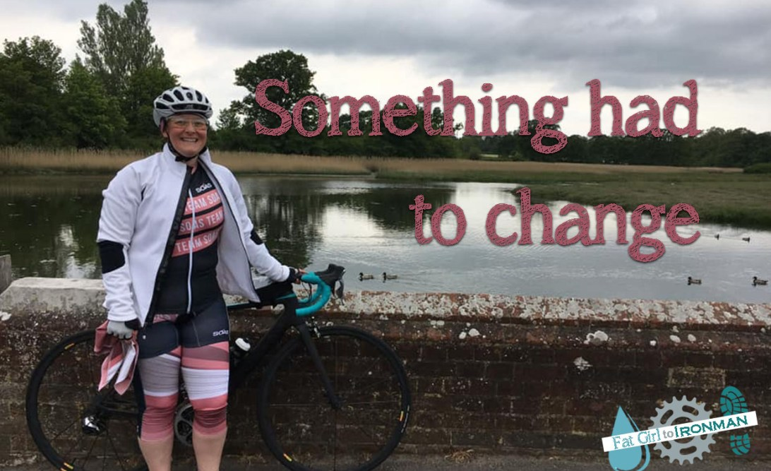 Tamsyn wearing SOAS cycling kit by a river with text superimposed on the picture 'Something had to change'.