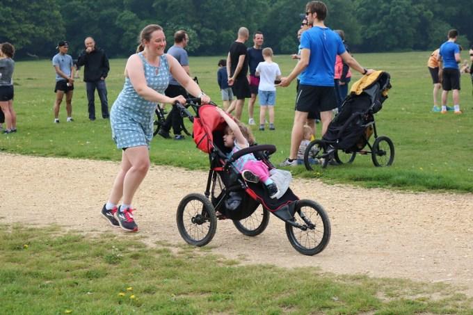 Tamsyn running whilst pushing a buggy. She is wearing a Ruu-Muu running dress.