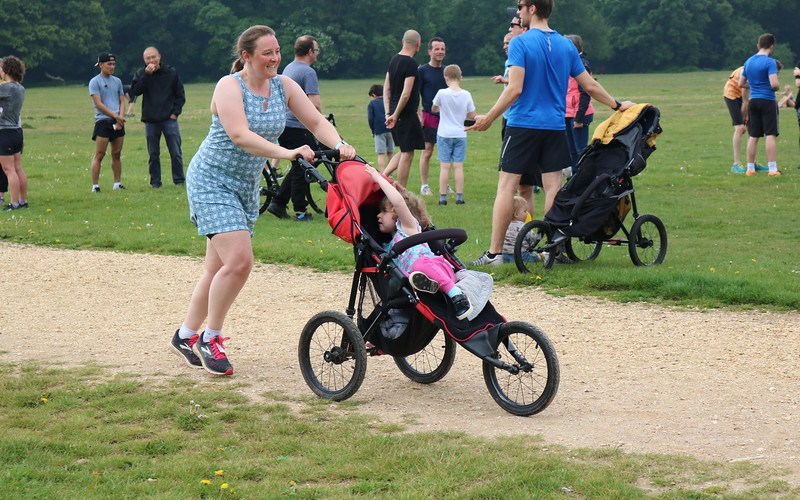 Tamsyn running whilst pushing a buggy. She is wearing a Ruu-Muu running dress.