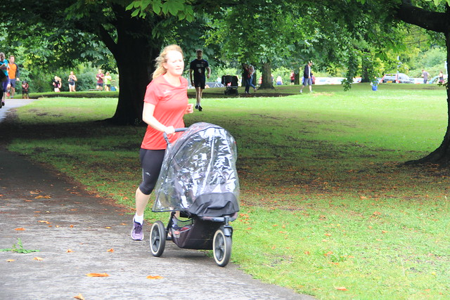 Rachel pushing her Phil and Teds buggy towards the finishing line.