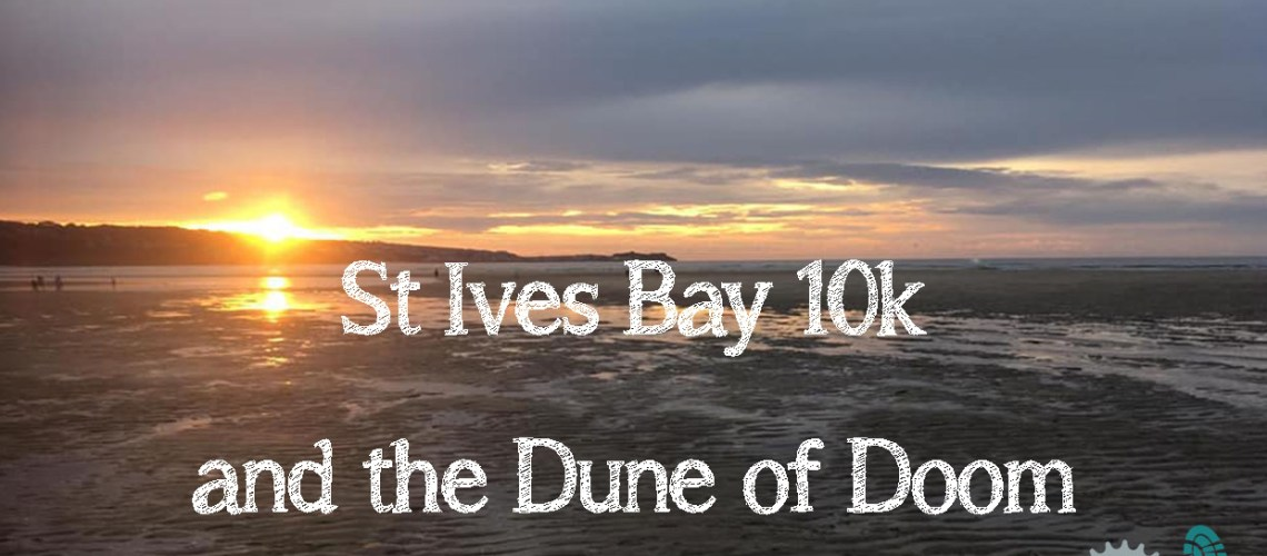 Sunset over St Ives bay with text superimposed on the mage saying 'St Ives Bay 10k and the Dune of Doom'.