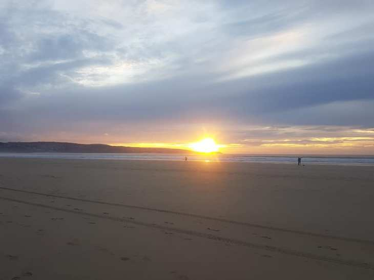 Sunset over St Ives from Hayle beach.