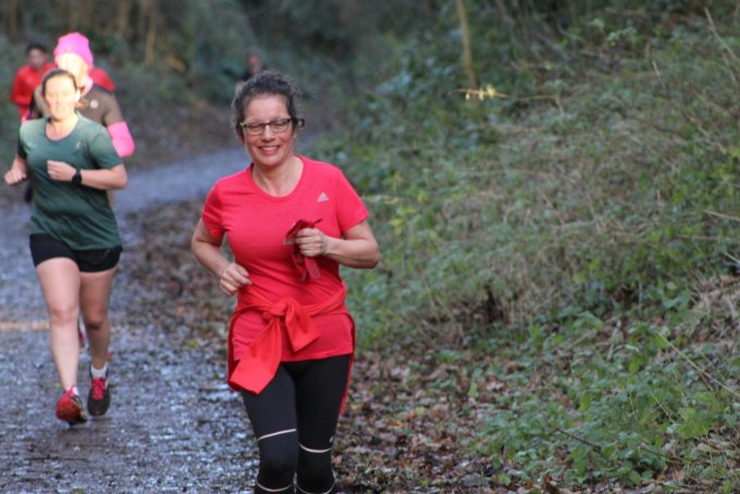 A runner at Blandford parkrun. Tamsyn can be seen in the background.