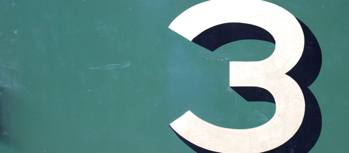 Photograph of the number 3 painted on a wall.