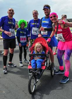 A buggy runner and people in fancy dress.