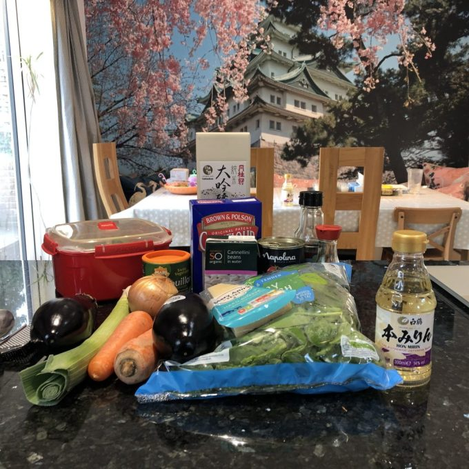 My ingredients assembled for the afternoon, including vegetables, cornflour, beans and Hakutsuru hon mirin. The ingredients are on a granite worktop. In the background there is an enormous picture of Nagoya Castle with cherry blossom by it.