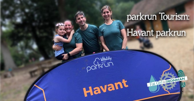 Stuart, Tamsyn, M and Kate in front of a banner saying Havant parkrun.