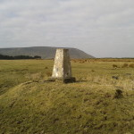 Stang Top Moor trig point with Pendle Hill in the background.