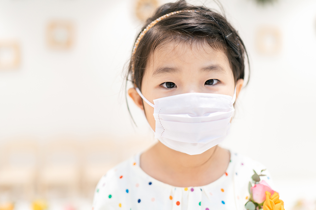 child wearing protective mask