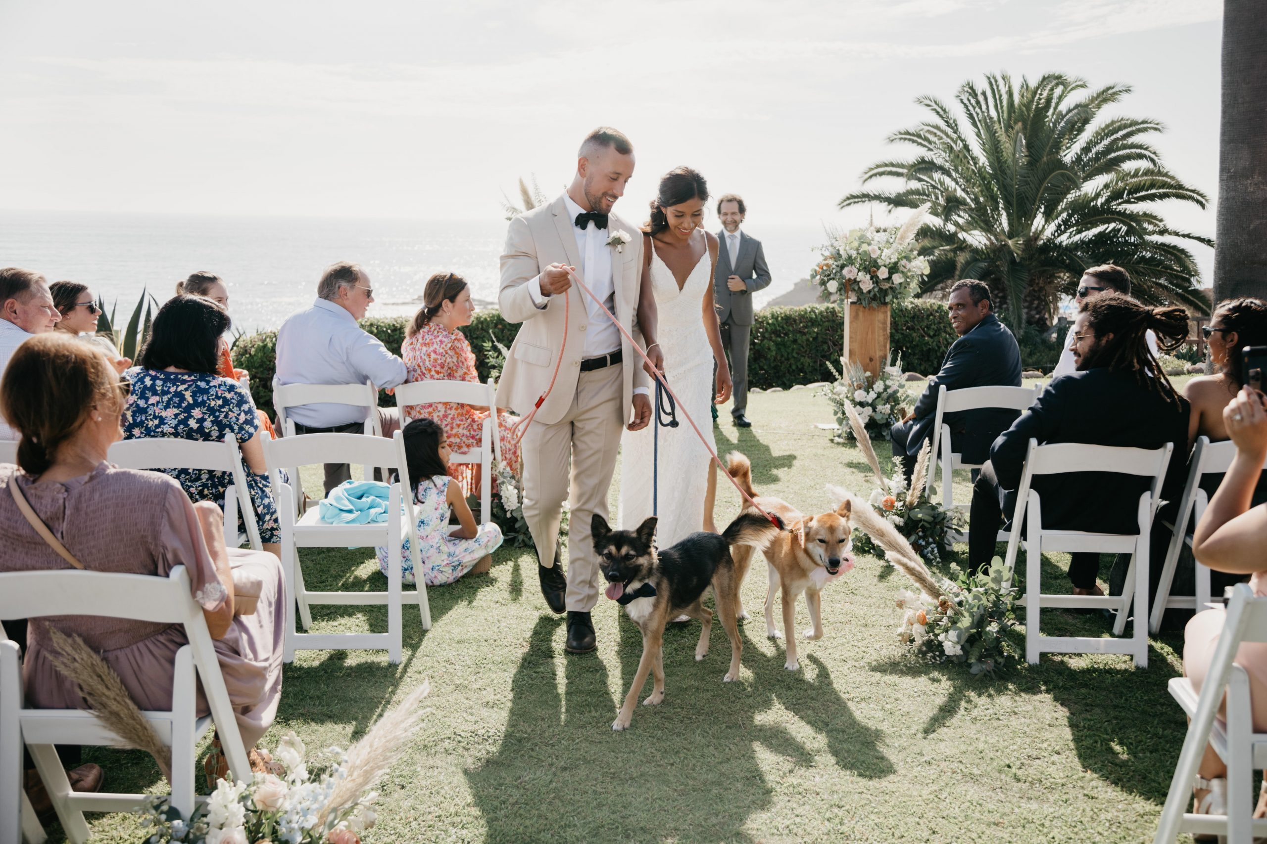 The Montage Laguna Beach Wedding, Couple walk down aisle with dogs, image by Fatima Elreda Photo