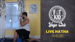 Marc practicing a low lunge with hands in anjali mudra