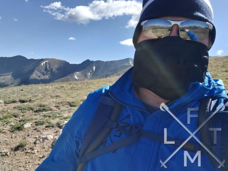 Trying to hike in July with a stocking cap, winter face mask and jacket on.