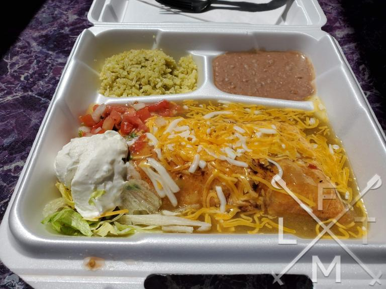 Steak Chimichanga from Adriana's Mexica Restaurant in Franktown.  It comes smothered in Green chili with rice and beans on the side.