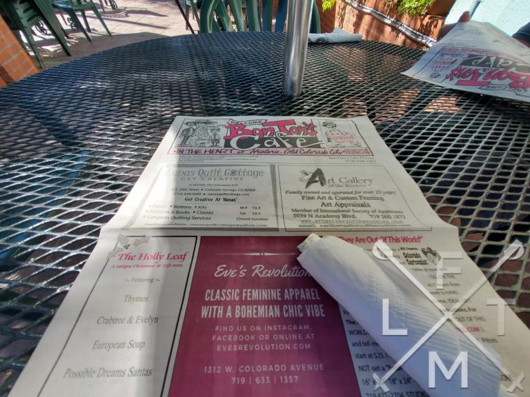 The cool newspaper that serves as the menu for Bon Ton's Cafe.  The paper can double as a take home keep sake.