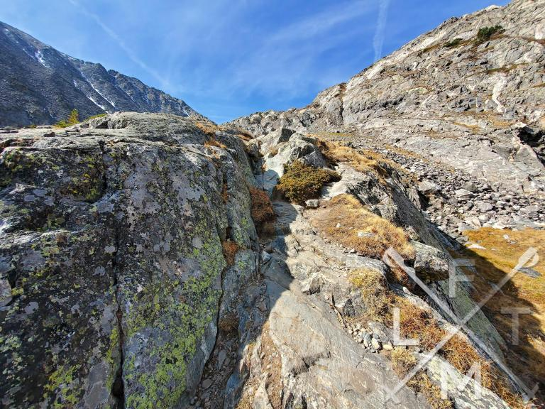 Part of the trail leading to the upper lake.  Solid rock with a steep ledge to it.