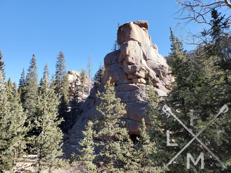 A rock spire coming out of the trees as you get close to the second forest.
