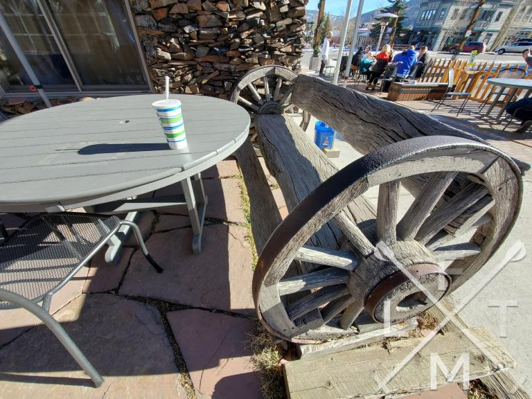 A cool bench built out of two wagon wheels and what looked to be  2 pieces of  driftwood.