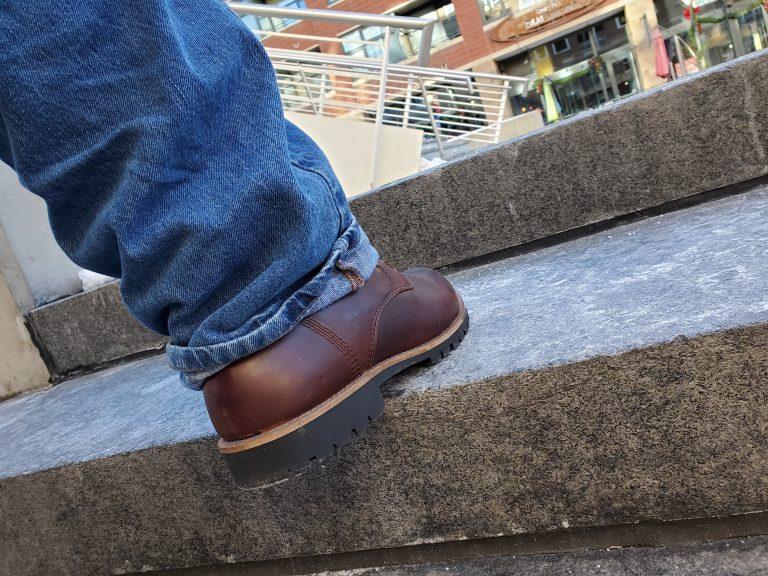 Kodiak Boots Moncton boots climbing an outdoor staircase.
