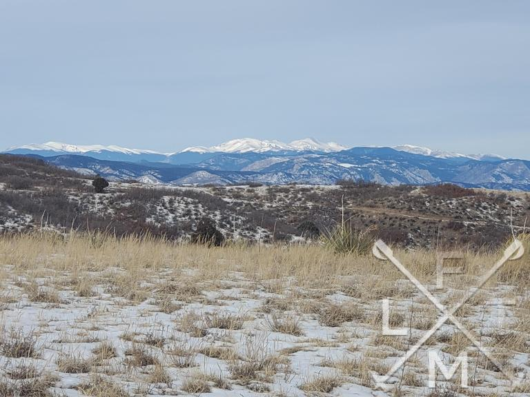 The mountains of the Front Range from one of the mesa's on the Ridgeline Open Space Loop hike.