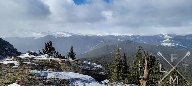 The view to the west from Chief Mountain with Mount Evans surrounded with a bit of clouds as a storm is moving in.