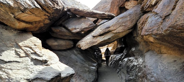Boulders that make a tunnel to walk under on the Mormon Loop to national Loop trail.