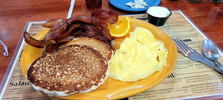 Scrambled eggs, 2 pancakes, and bacon from the Rock Springs Cafe.