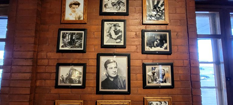 A wall full of celebrity photos at the El Rancho hotel.