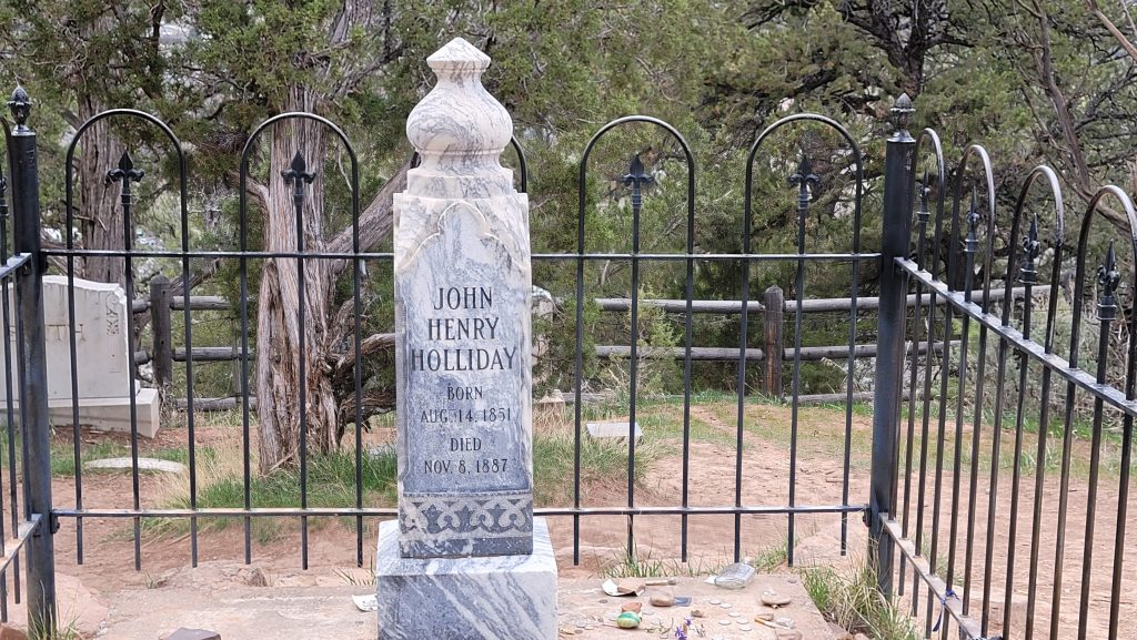 Doc Holiday's grave site in the cemetery.  A large stone monument is in place in a fenced in plot.