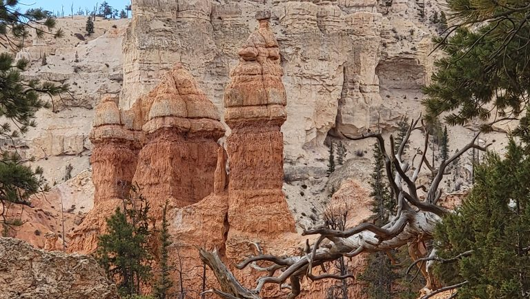 A series of three sandstone spires that look like a bishop chess piece as they taper to points at the top from the Peek-a-Boo Loop trail.