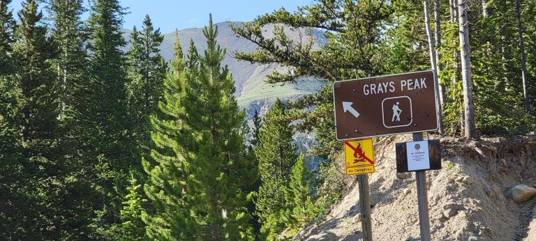 On the way to Grizzly Gulch a sign for Grays peak shows the direction to start the very popular 14er hike.