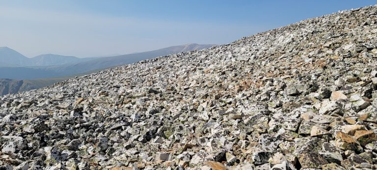 A field of jagged rocks covers the third hill on the way to the Pennsylvania Mountain Summit.