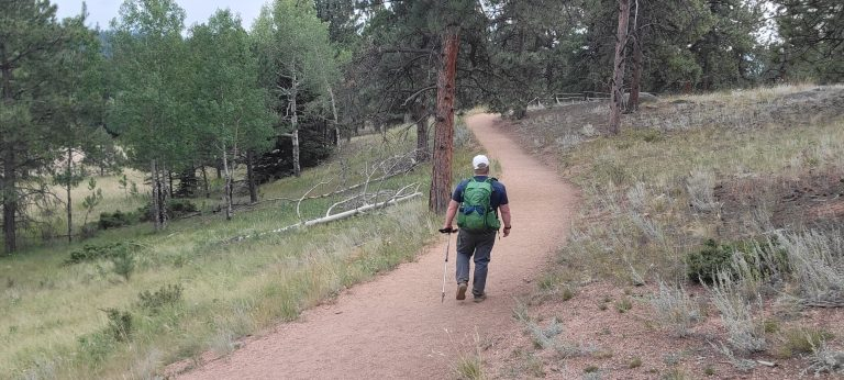 Me walking down the trail with my Osprey Manta 24 backpack.