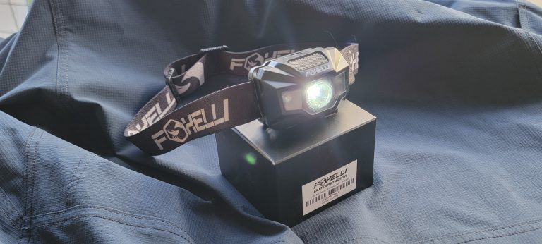 The Foxelli MX200 headlamp with the white light on.  The white light comes from the center opening of the headlamp.