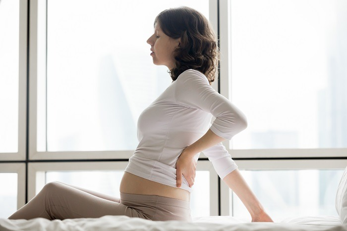 suffering from back pains post pregnancy tight hip flexor