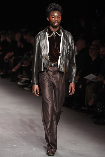 Model walks don the catwalk wearing the Autumn Whinter '16 collection for Wales Bonner at the MAN London Collection Fashion Show 2016