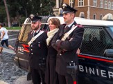 Tourist taking pictures with Carabinieri officers.