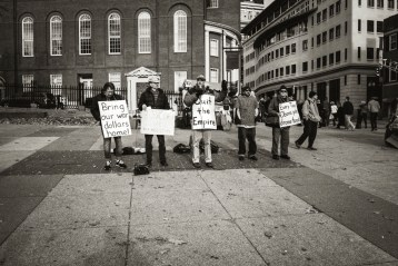 Protestors protesting about something at the Boston Common.