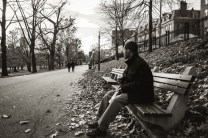 """Jonathan eating one of his doughnuts on """"The Common"""""""