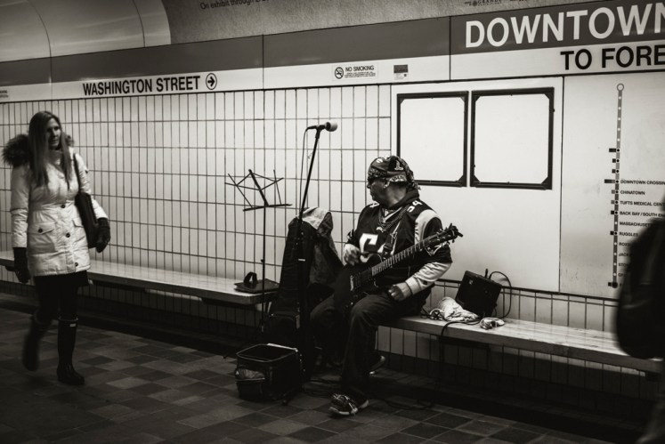 Patriots themed subway musician.
