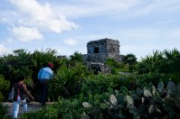 Tomas leading Carline through the Tulum ruins