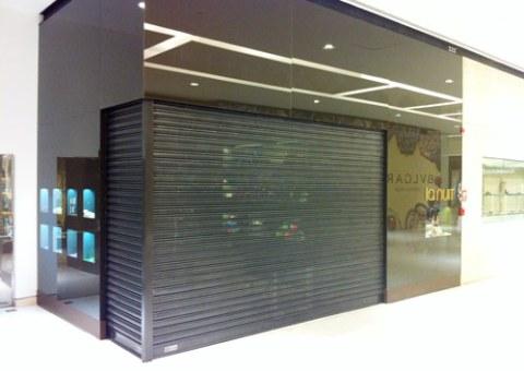 Porta de Aço de Enrolar Automática - Favaretto Portas - Porta de Enrolar para Shopping