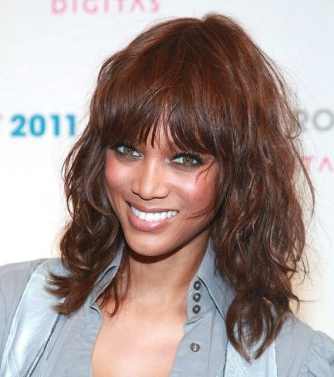 Medium length wavy hair with wispy bangs