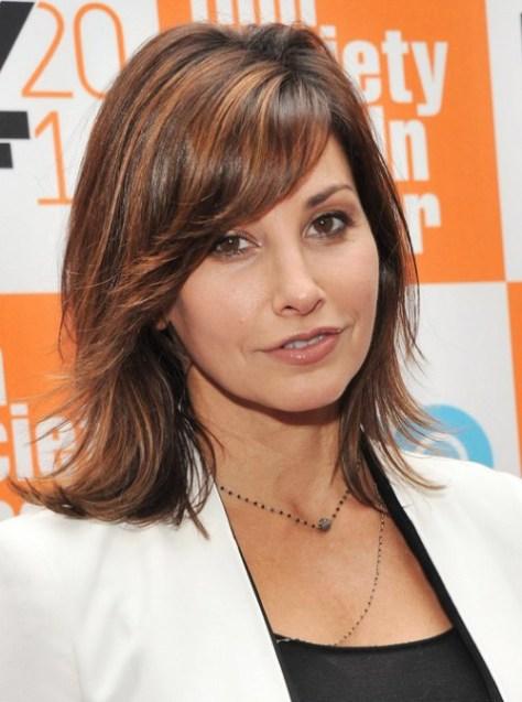 Gina Gershon medium layered haircut