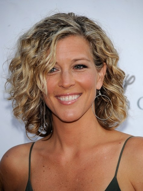 Short haircuts for women over 50 with curly hair