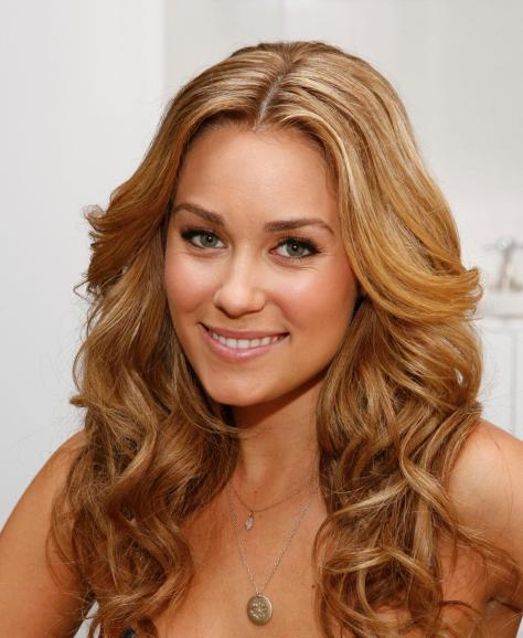 "Lauren Conrad, mark. spokesperson wears the Girls m.powerment campaign ""Have a Heart"" necklace. (PRNewsFoto/mark., Mark Von Holden) (Newscom TagID: prnphotos072872) [Photo via Newscom]"