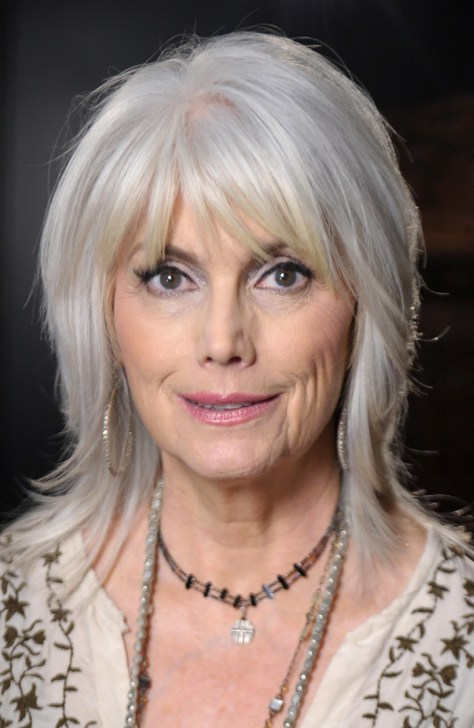 medium length hairstyles for women over 50 with bangs